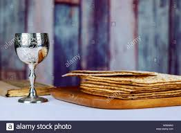 seder matzah kosher wine with a white plate of matzah or matza and a