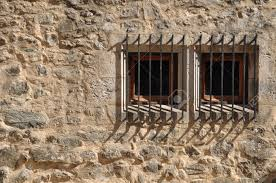 window and door bars 7783346 ancient windows of a medieval building with bars stock