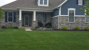 help me choose sherwin williams exterior paint to match this stone
