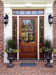 Wood Exterior Front Doors by Red Front Door Color For Brick House Flanked Black Outdoor Sconces