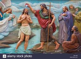 jesus being baptized by john the baptist while angels hold his