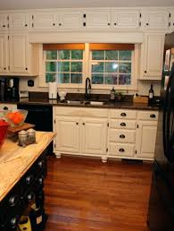 fancy white country kitchen with small french beige painting