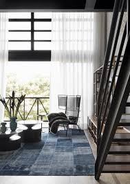 industrial loft with an open plan and a cool chromatic palette