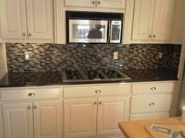 white kitchen cabinets black galaxy countertop gray glass mosaic