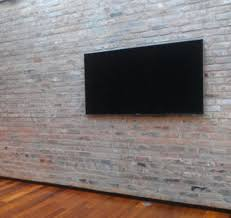 wall mounted tv hiding cables tv mounted on brick wall with no visible cables bonus