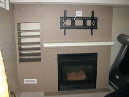 mounting flat screen tv above fireplace view in gallery cozy