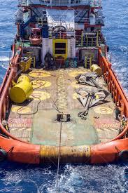 anchor handling tug deploying anchors of construction barge at