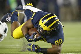 Michigan how long to travel a light year images For michigan fb khalid hill tears may flow a second time after jpg