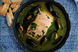 poached salmon and mussels in saffron broth