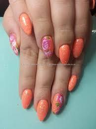 orange gel polish with one stroke flower nail art lack