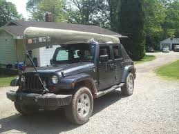 transport a kayak on top of a soft top jkowners com jeep