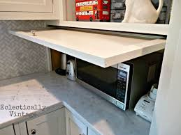 Best  Appliance Garage Ideas On Pinterest Appliance Cabinet - Kitchen cabinet roller doors