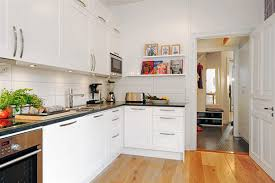 small space kitchen white stone tile floor beige stone bevel