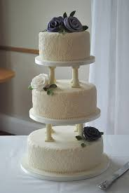 cake pillars 3 tier wedding cake with pillars piped lace and made