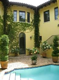 ivy covered walls on this old spanish home in coconut grove fl