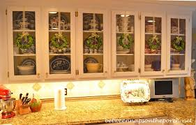 Glass Cabinet For Kitchen Decorate Kitchen Cabinets With Preserved Boxwood Wreaths For Christmas