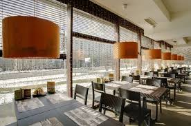 gorgeous restaurant interior design with white and green color for