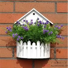 simple white wood wooden fence wall hanging basket flower basket