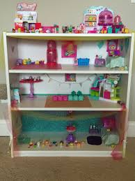 shopkins house bookshelf from walmart and added some decorations