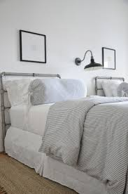 coastal inspired bedroom twin beds ticking stripe bedding