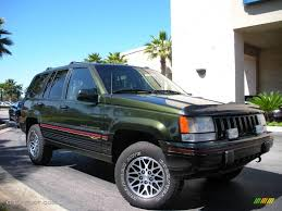 tan jeep grand cherokee 1995 moss green pearl jeep grand cherokee orvis 4x4 3588628 photo