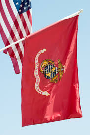 United States American Flag States Marine Corps Flag Waving On Blue Sky Background Close Up