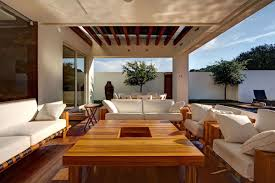 outdoor living room pergola brown wooden floor old brick wall