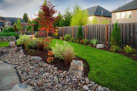 outdoor yard with river rock and drought tolerant plants river