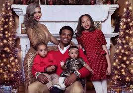 newton and the family pose in new pics