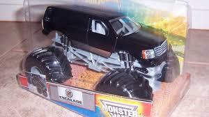 monster jam diecast trucks monster jam custom monster truck 1 24 black an escalade youtube