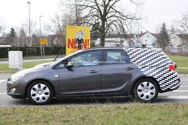 opel saturn spied opel vauxhall saturn astra sports tourer automotorblog