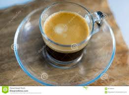 top of coffee cup frothy black coffee in glass mug on table stock photo image