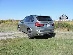 bmw minivan 2015 bmw x5 m vs porsche cayenne turbo s vs range rover sport svr