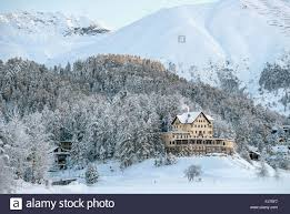 hotel waldhaus am see in a winter landscape at lake st moritz