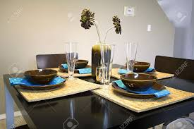 kitchen table setting ideas closeup on a setup dinner table in a kitchen stock photo picture