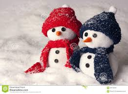 photo of two hand made snowman in blue and red color stock photo