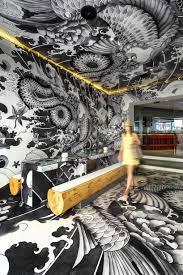vincent coste inks japanese restaurant with yakuza tattoo motifs vincent coste japanese restaurant koi yakuza tattoo interiors