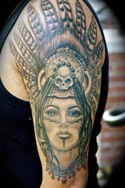 grey ink aztec women with skull tattoo design on sleeve