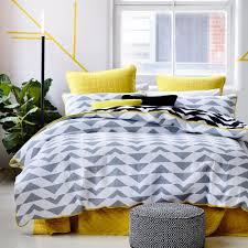 Yellow And Gray Bedroom by Featuring A Unique And Contemporary Geometric Triangle Pattern And