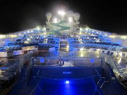 carnival cruise line carnival glory ship pool at night flickr