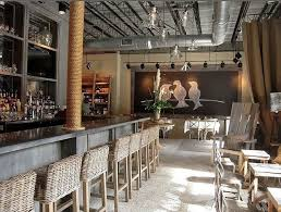 Industrial Interior Design Wren Restaurant Covered Column Burlap Draperies Blackboard