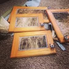 Western Style Kitchen Cabinets Cowhide From Hobby Lobby And Upholstery Tacks Here I Come