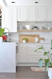 white kitchen cabinets with gold pulls how to choose kitchen door handles your home beautiful