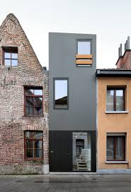 Modern Narrow House by A Narrow House Squeezed In Between Two Adjacent Buildings In