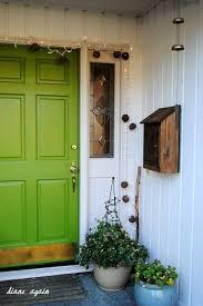 green front porch light front porch green front door twinkle lights grapevine balls blue