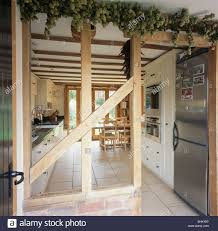 wall with plaster removed to expose beams in country kitchen with