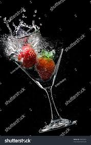 martini strawberry view martini glass strawberry on black stock photo 33879649