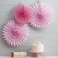 pink tissue paper fan decorations by