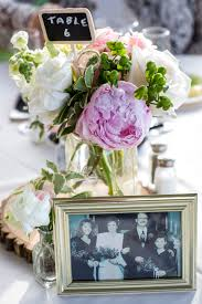 Shabby Chic Flower Arrangement by Centerpiece Featuring Log Rounds Mason Jar Floral Arrangement