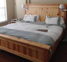brown teak bed frame with double bedside table on the floor